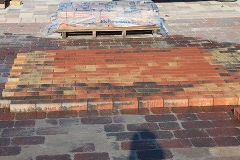 Pavers laid out in a Pallet Blend of two different paver colors